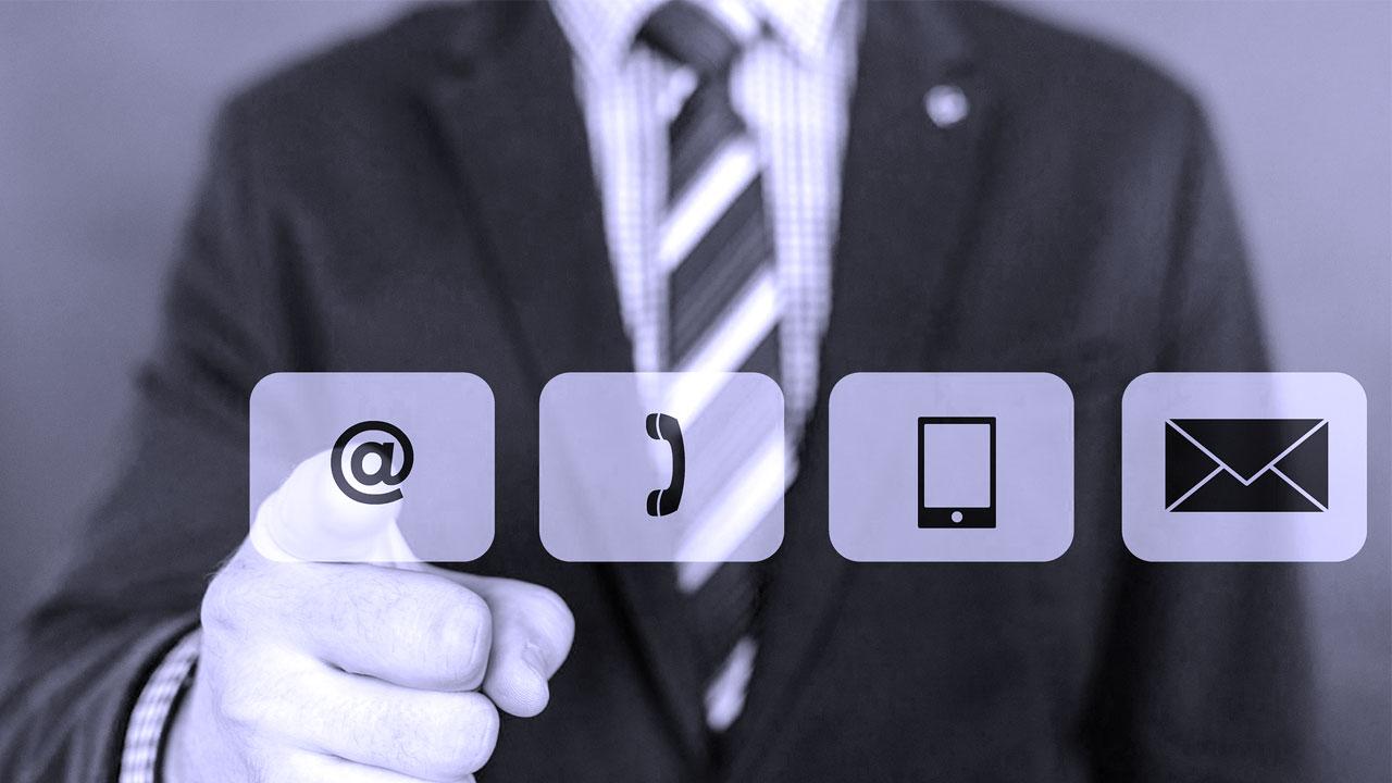 Business man pointing at contact symbols