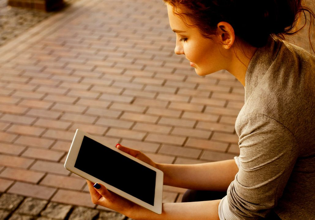 Young lady on wireless device